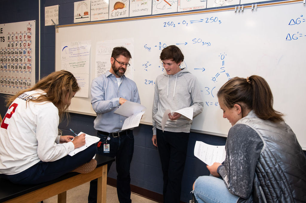 science teacher discusses work with students