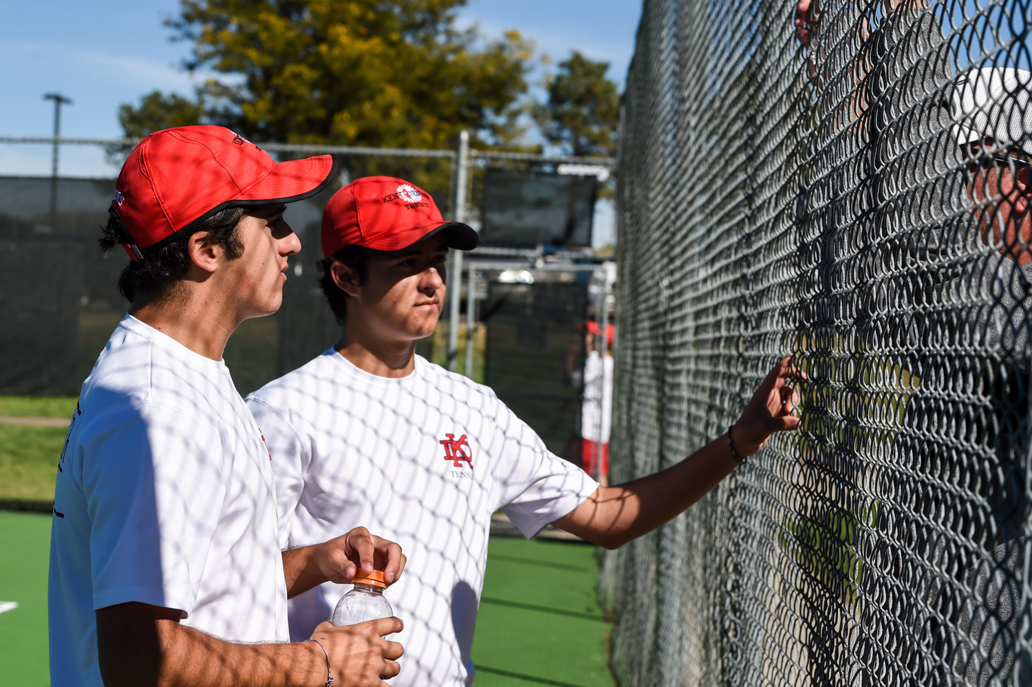 tennis payers consult with coach